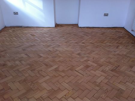 Pitch Pine Parquet Restoration in North Wales by Woodfloor-Renovations