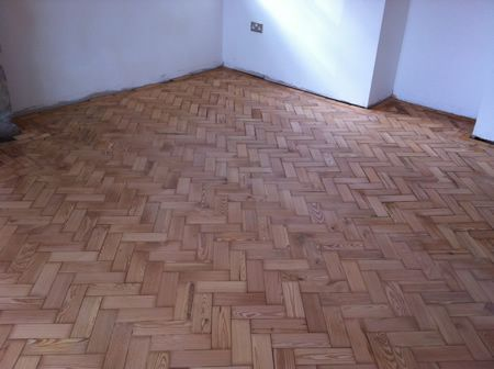 Pitch Pine Parquet Flooring Restoration in North Wales by Woodfloor-Renovations